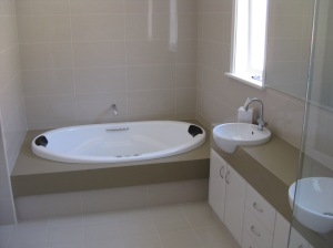Ensuite bathroom,inset bath on stone