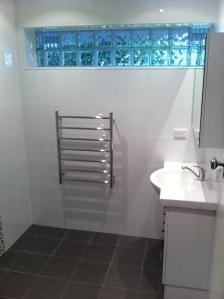 renovation. glassblock window installed & 10mm shower panel